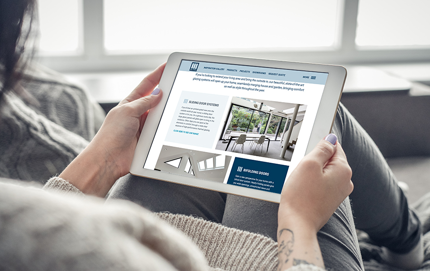 Mockup image of woman's hand holding white tablet pc with blank white screen at home